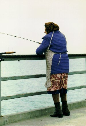 a lady fishing on the pier